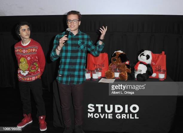 Hunter Payton and Justin Tinucci speak to the audience at Hunter Payton And The Shoe Crew Holiday Charity Fundraiser Screening of Illumination's 'The...