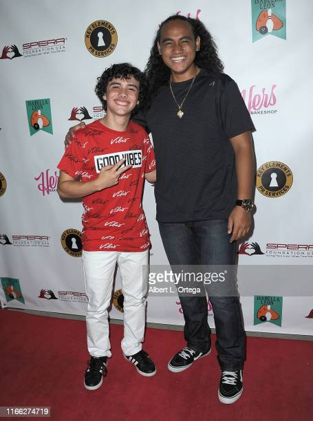 Hunter Payton Mendoza and Siaki Sii attend Isabella Leon's 12th Birthday Party held at Montrose Bowl on September 5, 2019 in Montrose, California.