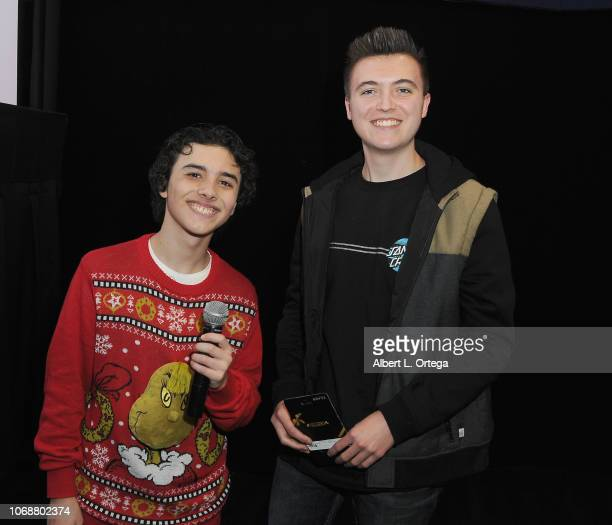 Hunter Payton poses with raffel winner Daniel Thornton at the Hunter Payton And The Shoe Crew Holiday Charity Fundraiser Screening of Illumination's...