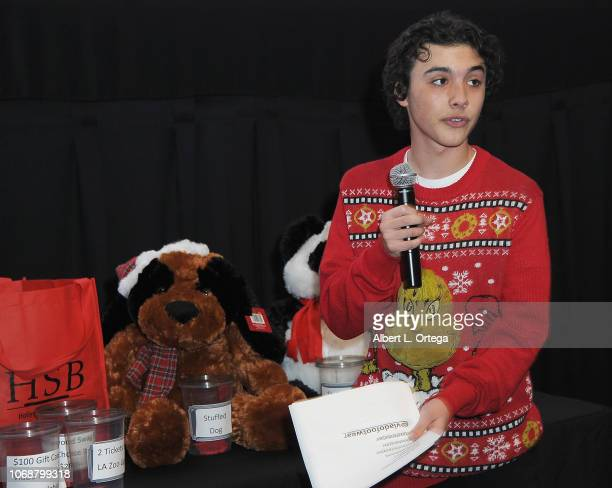 Hunter Payton speaks to the audience at the Hunter Payton And The Shoe Crew Holiday Charity Fundraiser Screening of Illumination's 'The Grinch'...