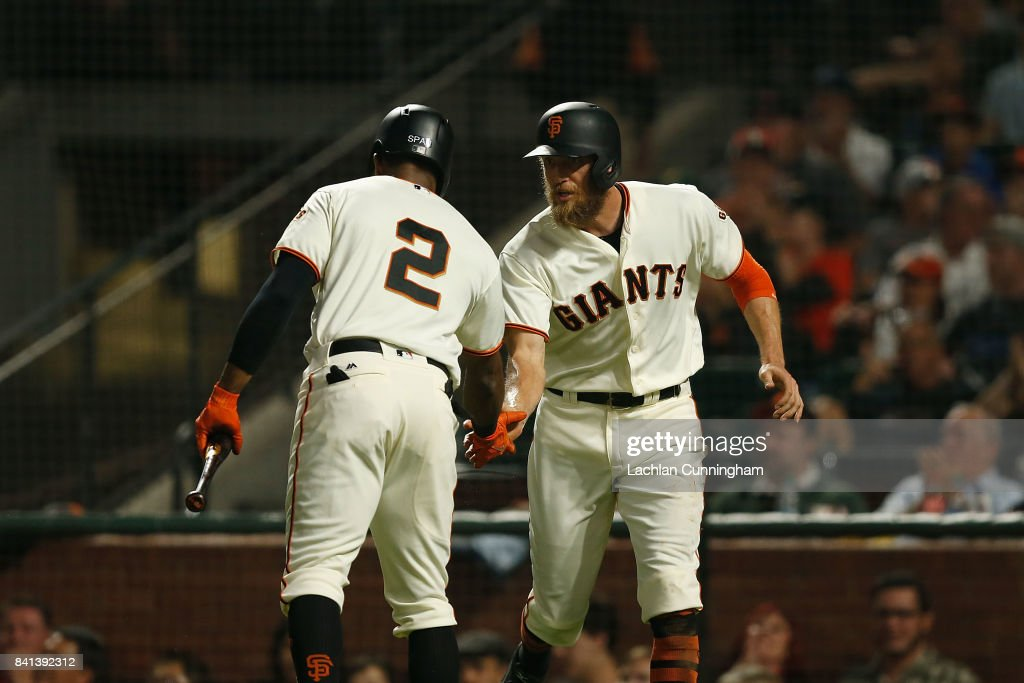 Hunter Pence (right) #8 of the San Francisco Giants celebrates with Denard Span #2 after scoring on a sacrifice fly hit by Carlos Moncrief #39 of the San Francisco Giants in the fifth inning against the St Louis Cardinals at AT&T Park on August 31, 2017 in San Francisco, California.