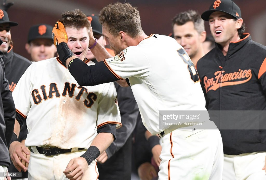 Hunter Pence #8 and Christian Arroyo #22 of the San Francisco Giants celebrates after Pence hit a walk-off sacrifice fly to score Gorkys Hernandez to defeat the Los Angeles Dodgers 4-3 in the bottom of the tenth inning at AT&T Park on April 26, 2017 in San Francisco, California.