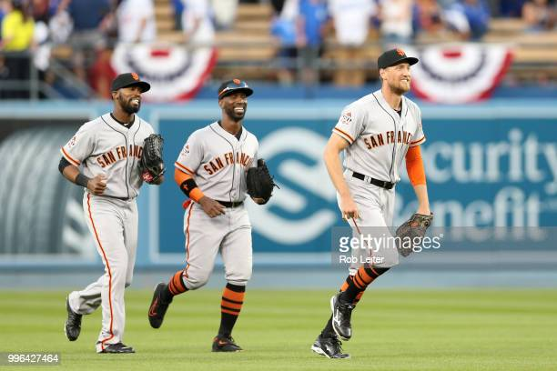 Hunter Pence Austin Jackson and Andrew McCutchen of the San Francisco Giants run off the field after winning the game against the San Francisco...