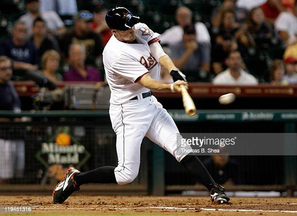 Hunter Pence of the Houston Astros hits a triple in the first inning against the Washington Nationals on July 20 2011 at Minute Maid Park in Houston...