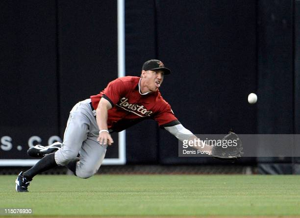 Hunter Pence of the Houston Astros makes a diving catch on a ball hit by Ryan Ludwick of the San Diego Padres during the first inning of a baseball...
