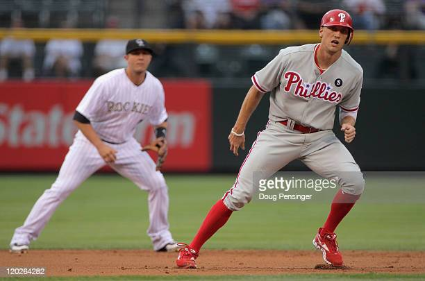 Hunter Pence of the Philadelphia Phillies leads off second base in front of shortstop Troy Tulowitzki of the Colorado Rockies after his RBI double...