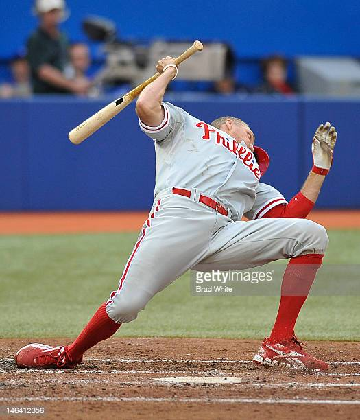 Hunter Pence of the Philadelphia Phillies reacts to an inside pitch during interleague MLB game action against the Toronto Blue Jays June 15 2012 at...