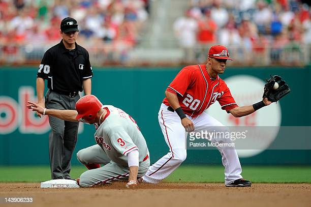 Hunter Pence of the Philadelphia Phillies slides safely into second base against Ian Desmond of the Washington Nationals Nationals Park on May 5 2012...