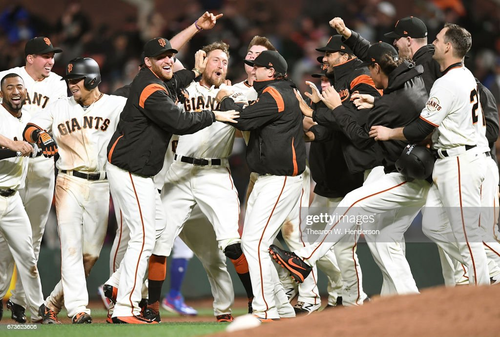Hunter Pence #8 of the San Francisco Giants and his teammates celebrate after Pence hit a walk-off sacrifice fly to score Gorkys Hernandez to defeat the Los Angeles Dodgers 4-3 in the bottom of the tenth inning at AT&T Park on April 26, 2017 in San Francisco, California.