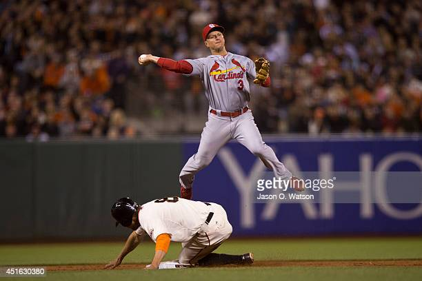 Hunter Pence of the San Francisco Giants breaks up a double play attempt after being forced out at second base by Mark Ellis of the St Louis...
