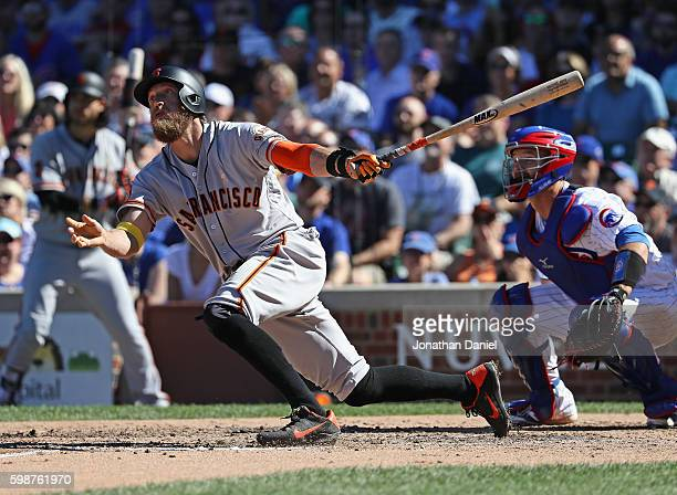Hunter Pence of the San Francisco Giants breaks up a nohit bid by Jon Lester of the Chicago Cubs with a solo home run in the 7th inning at Wrigley...