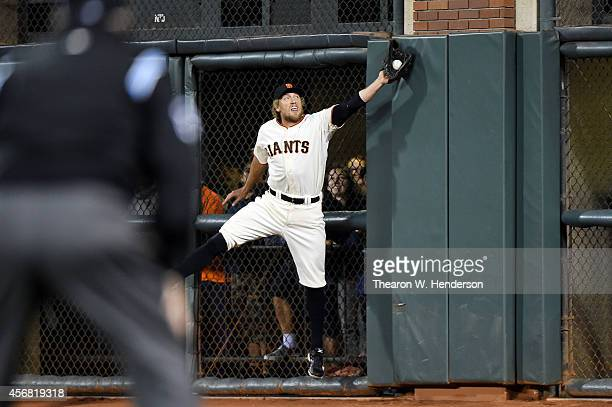 Hunter Pence of the San Francisco Giants catches a ball hit by Jayson Werth of the Washington Nationals for an out in the sixth inning during Game...