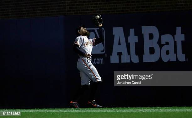 Hunter Pence of the San Francisco Giants catches a fly ball in the second inning against the Chicago Cubs at Wrigley Field on October 7, 2016 in...