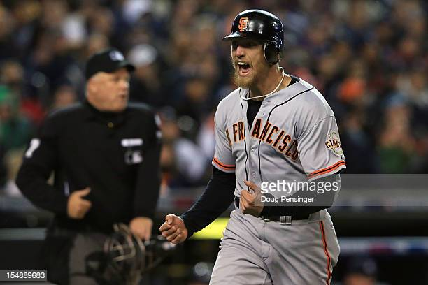 Hunter Pence of the San Francisco Giants celebrates after scoring a run off of Brandon Belt RBI against Max Scherzer of the Detroit Tigers in the...