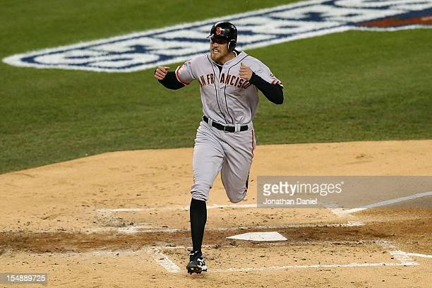 Hunter Pence of the San Francisco Giants celebrates after scoring a run off of Brandon Belt RBI triple to right field against Max Scherzer of the...