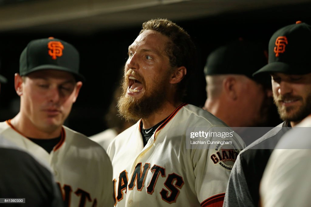Hunter Pence #8 of the San Francisco Giants celebrates after scoring on a sacrifice fly hit by Carlos Moncrief #39 of the San Francisco Giants in the fifth inning against the St Louis Cardinals at AT&T Park on August 31, 2017 in San Francisco, California.