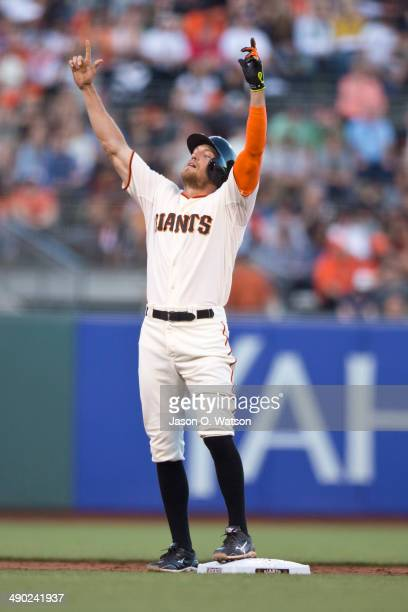Hunter Pence of the San Francisco Giants celebrates at second base after hitting a double against the Atlanta Braves during the first inning at ATT...