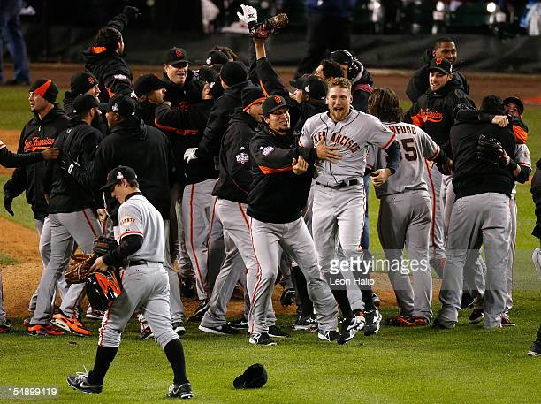 Hunter Pence of the San Francisco Giants celebrates with his teammates after they defeated the Detroit Tigers in the tenth inning to win Game Four of...