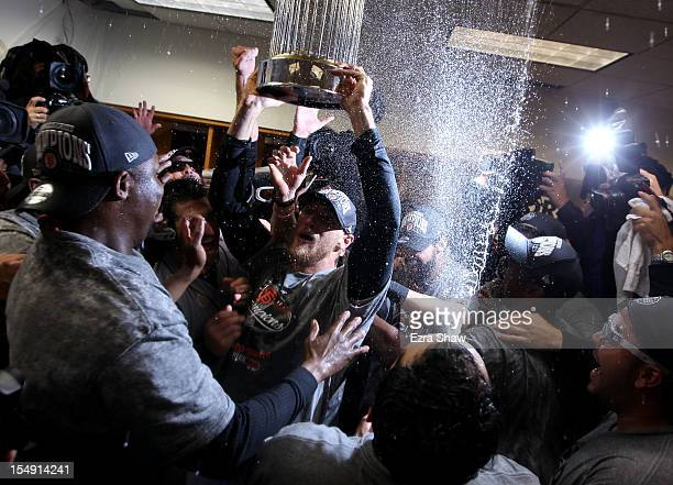Hunter Pence of the San Francisco Giants celebrates with his teammates and the Commissioner's Trophy in the lockeroom after defeating the Detroit...