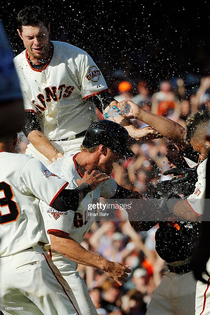 Hunter Pence #8 of the San Francisco Giants gets drenched at the mound after hitting a walk-off RBI fly ball to center field to beat the San Diego Padres 7-6 in nine innings at AT&T Park on September 29, 2013 in San Francisco, California.