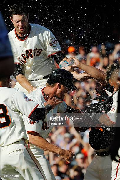 Hunter Pence of the San Francisco Giants gets drenched at the mound after hitting a walkoff RBI fly ball to center field to beat the San Diego Padres...