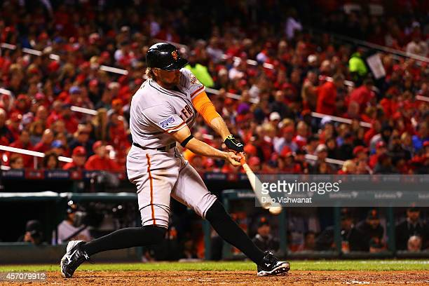 Hunter Pence of the San Francisco Giants grounds into a fielder's choice in the fifth inning against the St Louis Cardinals during Game One of the...