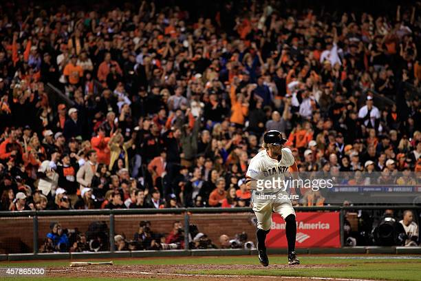 Hunter Pence of the San Francisco Giants hits a RBI single in the fifth inning against the Kansas City Royals during Game Four of the 2014 World...
