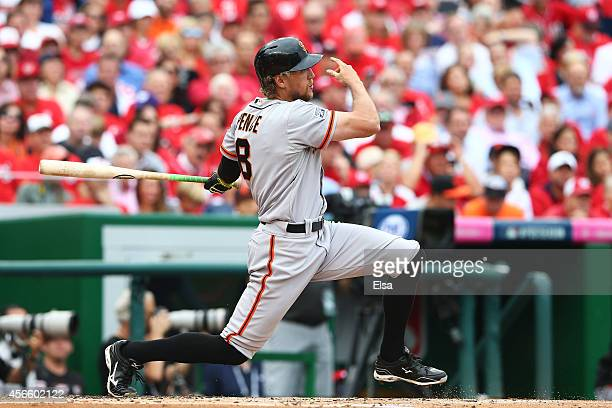 Hunter Pence of the San Francisco Giants hits a single in the second inning against the Washington Nationals during Game One of the National League...