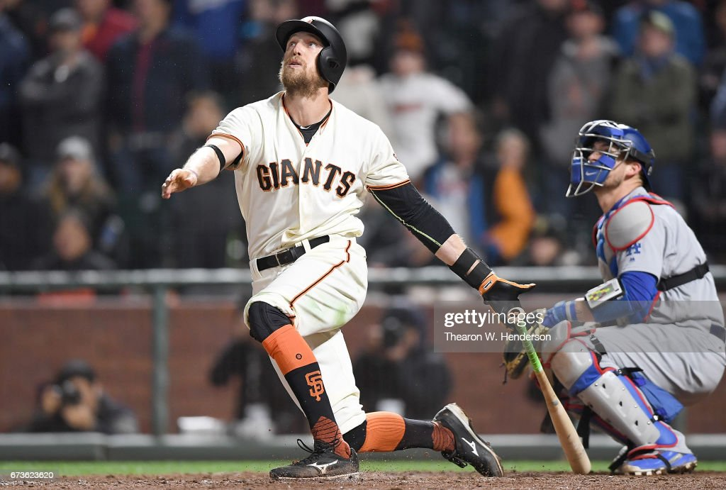 Hunter Pence #8 of the San Francisco Giants hits a walk-off sacrifice fly to score Gorkys Hernandez to defeat the Los Angeles Dodgers 4-3 in the bottom of the tenth inning at AT&T Park on April 26, 2017 in San Francisco, California.
