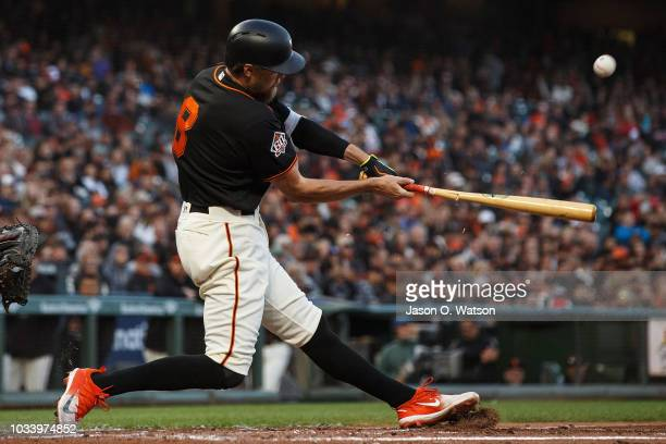 Hunter Pence of the San Francisco Giants hits an RBI single against the Colorado Rockies uring the second inning at ATT Park on September 15 2018 in...