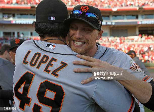 Hunter Pence of the San Francisco Giants hugs Javier Lopez after a win over the Cincinnati Reds in Game Five of the National League Division Series...