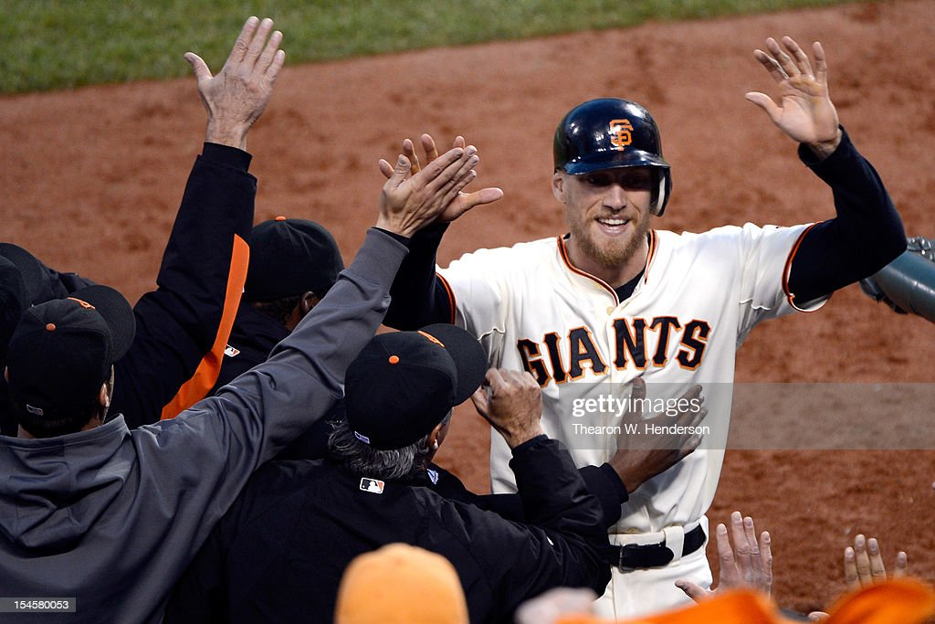 Hunter Pence #8 of the San Francisco Giants is congratulated at the dugout after scoring in the third inning against the St. Louis Cardinals in Game Seven of the National League Championship Series at AT&T Park on October 22, 2012 in San Francisco, California.