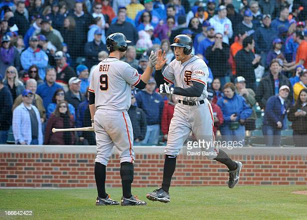 Hunter Pence of the San Francisco Giants is greeted by Brandon Belt after hitting a gametying homer against the Chicago Cubs during the ninth inning...