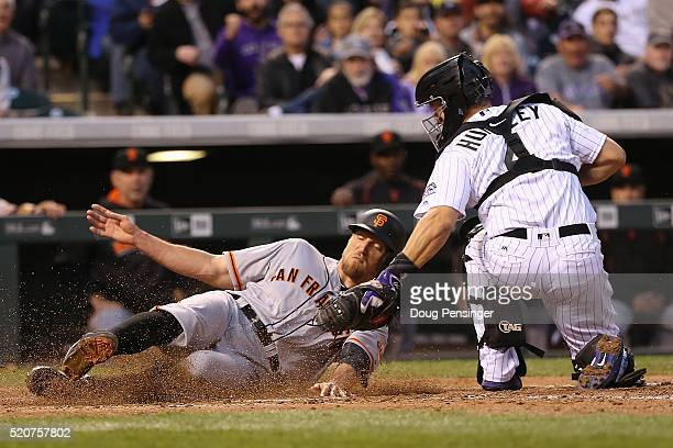 Hunter Pence of the San Francisco Giants is tagged out at home by catcher Nick Hundley of the Colorado Rockies while trying to score on single by...