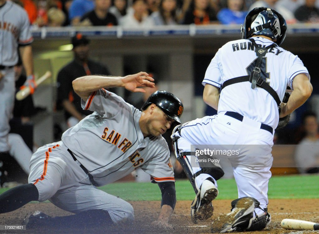 Hunter Pence #8 of the San Francisco Giants is tagged out by Nick Hundley #4 of the San Diego Padres as he tries to score during the sixth inning of a baseball game at Petco Park on July 11, 2013 in San Diego, California.