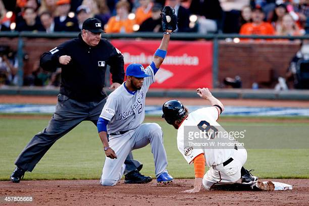Hunter Pence of the San Francisco Giants is tagged out stealing at second base by Alcides Escobar of the Kansas City Royals in the second inning...