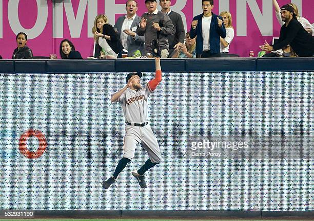 Hunter Pence of the San Francisco Giants jumps as he makes the catch on a ball hit by Jon Jay of the San Diego Padres during the sixth inning of a...