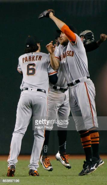 Hunter Pence of the San Francisco Giants leaps with teammates Jarrett Parker and Denard Span in celebration of a 92 victory against the Arizona...