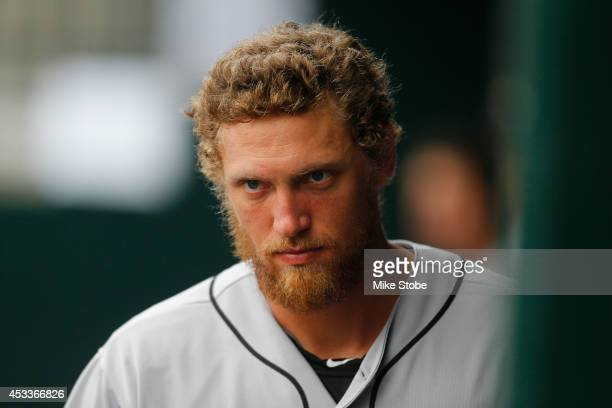 Hunter Pence of the San Francisco Giants looks on from the bench against the New York Mets at Citi Field on August 4, 2014 in the Flushing...