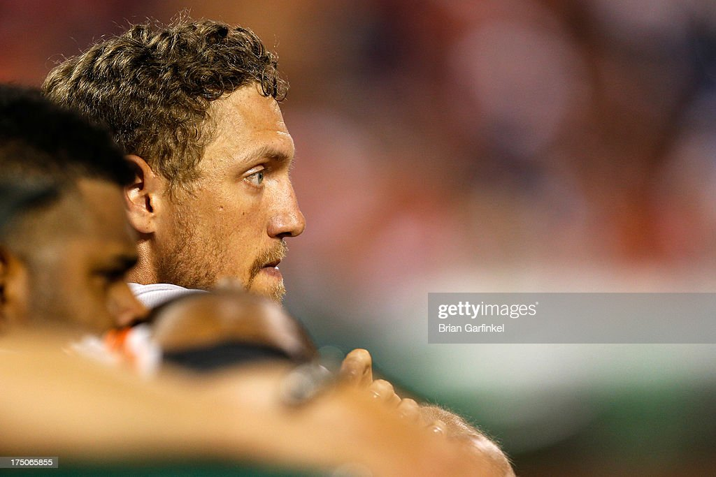 Hunter Pence #8 of the San Francisco Giants looks on from the dugout in the ninth inning of the game against the Philadelphia Phillies at Citizens Bank Park on July 30, 2013 in Philadelphia, Pennsylvania. The Phillies won 7-3.