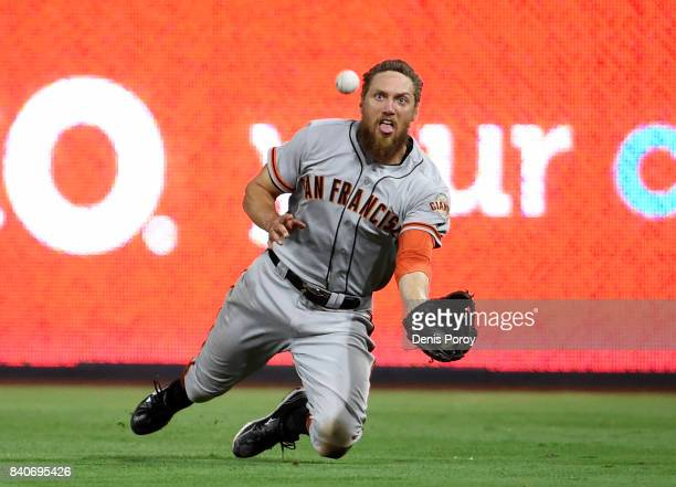 Hunter Pence of the San Francisco Giants makes a diving catch on a ball hit by Yangervis Solarte of the San Diego Padres during the seventh inning of...