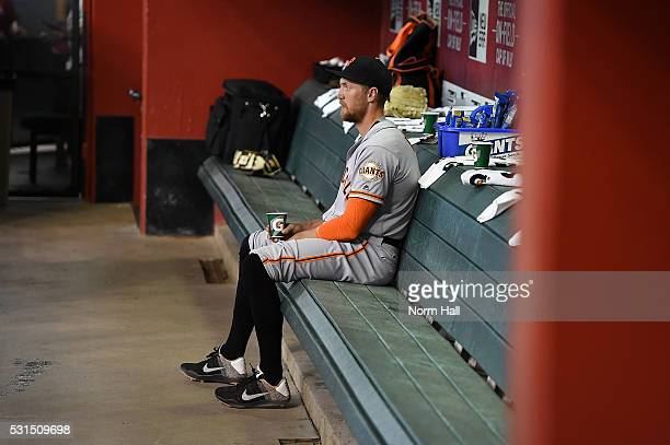 Hunter Pence of the San Francisco Giants prepares for a game while sitting in the dugout against the Arizona Diamondbacks at Chase Field on May 12...