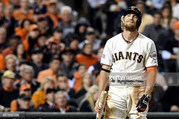 Hunter Pence of the San Francisco Giants reacts after striking out in the sixth inning against the St Louis Cardinals during Game Five of the...