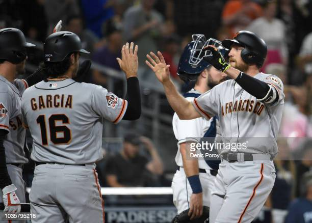 Chris Shaw of the San Francisco Giants hits a two RBI single during the eighth inning of a baseball game against the San Diego Padres at PETCO Park...