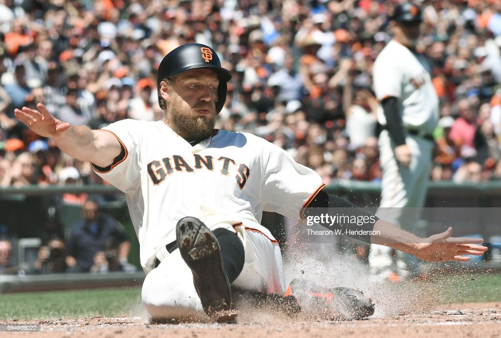 Hunter Pence #8 of the San Francisco Giants scores against the Minnesota Twins in the bottom of the fourth inning at AT&T Park on June 11, 2017 in San Francisco, California.