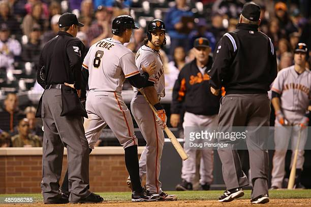 Hunter Pence of the San Francisco Giants seperates Angel Pagan of the San Francisco Giants from umpire John Tumpane after Tumpane ejected Pagan from...
