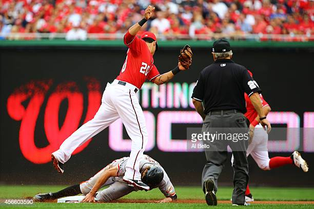 Hunter Pence of the San Francisco Giants steals second base against Ian Desmond of the Washington Nationals in the fourth inning during Game One of...