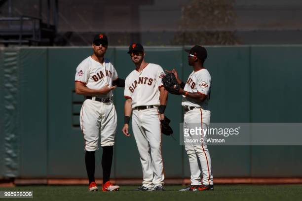 Hunter Pence of the San Francisco Giants Steven Duggar and Andrew McCutchen celebrate after the game against the St Louis Cardinals at ATT Park on...