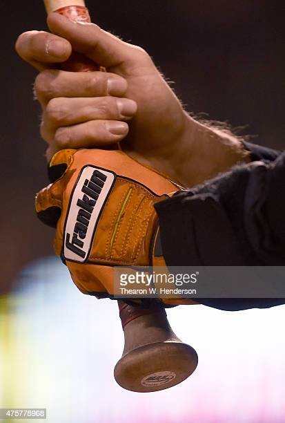 Hunter Pence of the San Francisco Giants wearing Franklin batting gloves holds onto the handle of his bat while in the ondeck circle against the...
