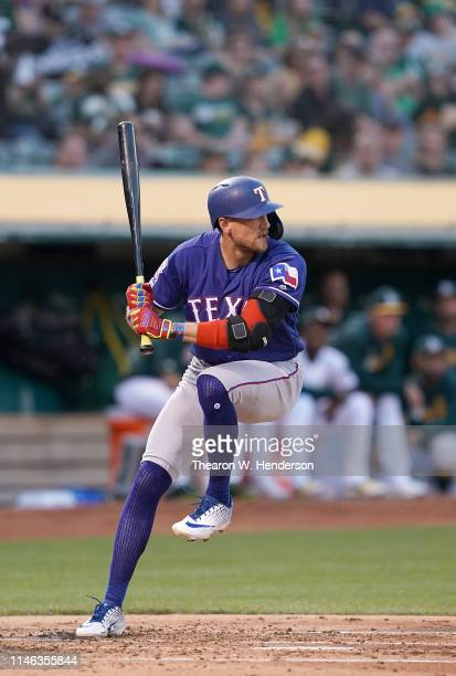 Hunter Pence of the Texas Rangers bats against the Oakland Athletics in the top of the second inning of a Major League Baseball game at...